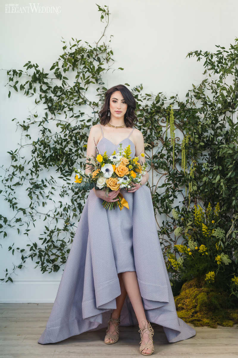 And elegant gray gown complimented by a yellow bouquet
