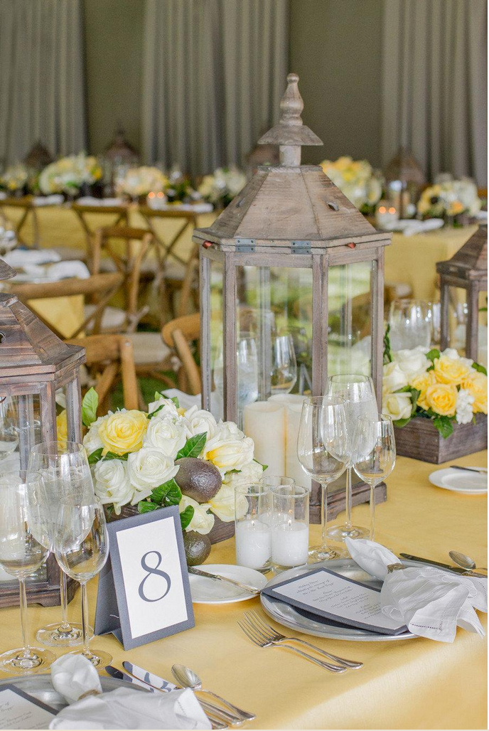 Summery table design with yellow florals and table cloths and gray accents